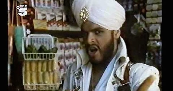 We Can't Stop Watching This Vintage Commercial Featuring An Elvis Impersonator Wearing A Turban